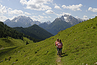 Germany, Bavaria, Hikers on Ramsau mountain pasture experience path - LB000363
