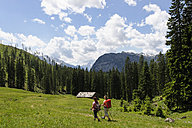 Germany, Bavaria, Hikers on Ramsau mountain pasture experience path - LB000369