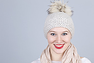 Portrait of young woman with bobble hat - DRF000262