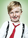 Portrait of smiling little boy, studio shot - STKF000379