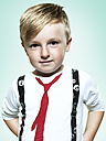 Portrait of confident little boy, studio shot - STKF000382