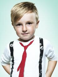 Portrait of confident little boy, studio shot - STKF000382