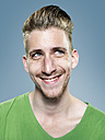 Portrait of smiling young man, studio shot - STKF000414