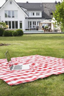 Germany, Cologne, Laptop on blanket in garden - PDF000516
