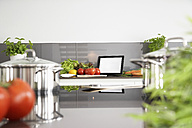 Germany, Cologne, Pot and vegetables on kitchen surface - PDF000564