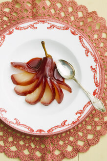 Poached pears in red wine on plate - ECF000365