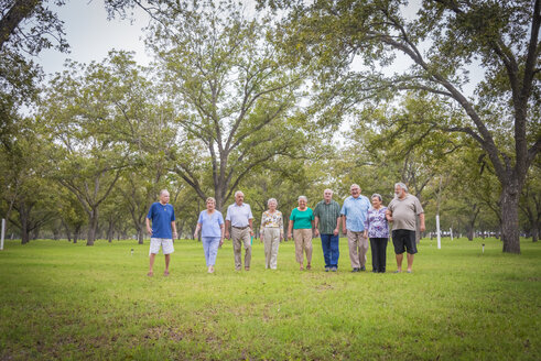 USA, Texas, Group  of senior citizens in park - ABAF001057