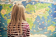 Girl in front of world map - SAR000119