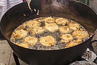 Germany, Bavaria, Wallgau, Apple pancakes frying in hot oil - TCF003615