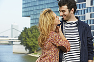 Germany, Dusseldorf, Young couple embracing - STKF000434