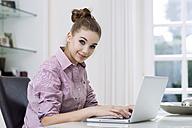 Portrait of teenage girl using laptop - GDF000273