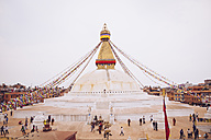 Nepal, Kathmandu, Bodnath, Stupa sanctuary with prayer flags - MBE000812