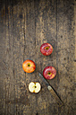 Apples and knife on wooden table - LVF000267