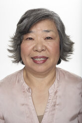 Portrait of laughing senior Asian woman, studio shot - FSF000085
