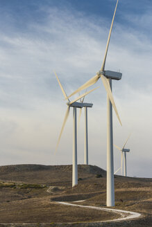 Spain, Andalusia, Cadiz, wind turbines standing on a field - KB000004