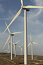 Spain, Andalusia, Cadiz, wind turbines standing on a field - KBF000001
