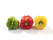 Row of red, green and yellow bell peppers - SRSF000339