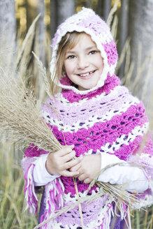 Germany, Vilsbiburg, Girl wearing poncho, portrait - STB000130