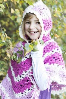 Germany, Vilsbiburg, Girl wearing poncho, portrait - STB000127