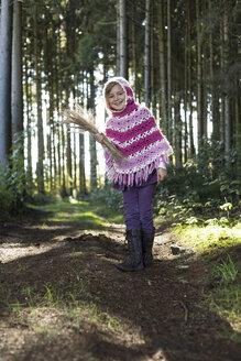 Germany, Vilsbiburg, Girl in forest, wearing poncho - STB000116