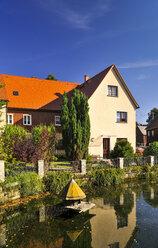 Germany, Saxony, Hinterhermsdorf, House at a pond - BT000259