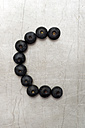 Blueberries forming letter C on sheet metal - AWDF000718