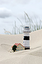 Germany, Amrum, Models of lighthouse and house in sand - AWDF000726