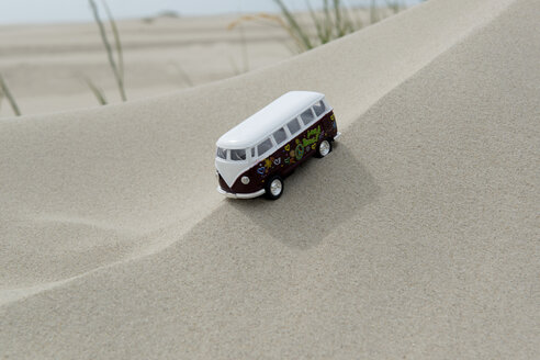Germany, Amrum, Toy bus on dune - AWD000739