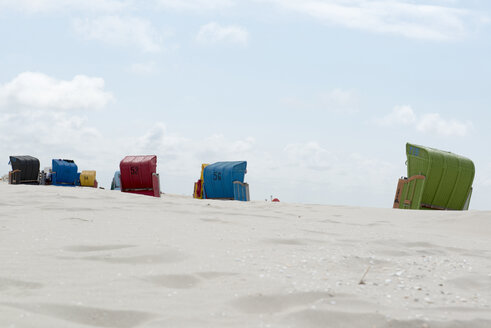 Germany, Amrum, Beach chairs in beach - AWDF000729