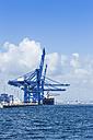 Spain, Andalusia, Algeciras, Cargo ship at pier - KB000030