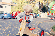 Germany, Bonn, Little boy with wood tricycle - MFF000614