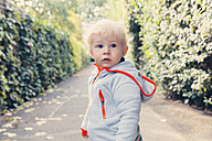 Germany, Bonn, Baby boy standing in street - MFF000610