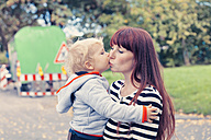 Germany, Bonn, Baby boy kissing mother - MFF000620
