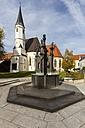 Germany, Bavaria, Upper Bavaria, Altoetting, fountain with figurines, behind collegiate church - AM001136