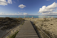 Spain, Formentera, Es Arenals, wooden boardwalk at the beach - CM000015