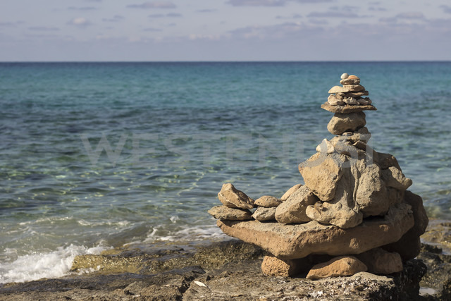 Spain, Formentera, pyramide made of stones at Playa de Migjorn - CM000014