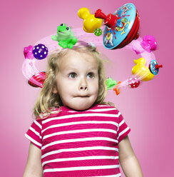 Little girl with flying toys around her head, Composite - STKF000504