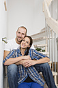 Happy young couple in new home - FKF000315