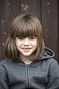 Portrait of smiling little girl with hoodie jacket - LV000317