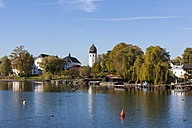 Germany, Bavaria, Upper Bavaria, Chiemgau, View of Frauenchiemsee Island at Lake Chiemsee, tower of the Order of Saint Benedict - AMF001163