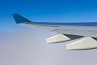 View of airplane wing over clouds - AMF001178
