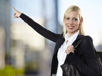Portrait of business woman pointing at something - STKF000528