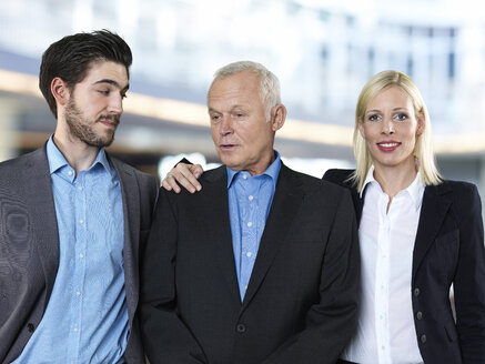 Portrait of two business men and a business woman - STKF000510