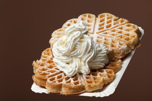 Two waffles with cream on wooden plate - WSF000046