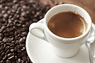 Espresso and coffee beans on table - STKF000619