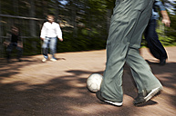 Friends playing soccer on soccer pitch - STKF000684