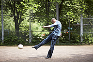 Soccer player kicking ball on soccer pitch - STKF000652
