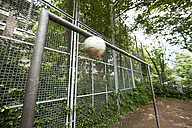 Soccer ball mid-air at goal - STKF000661