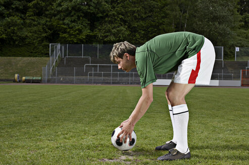 Soccer player placing ball on penalty spot - STKF000671
