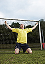 Soccer player celebrating on field - STKF000669